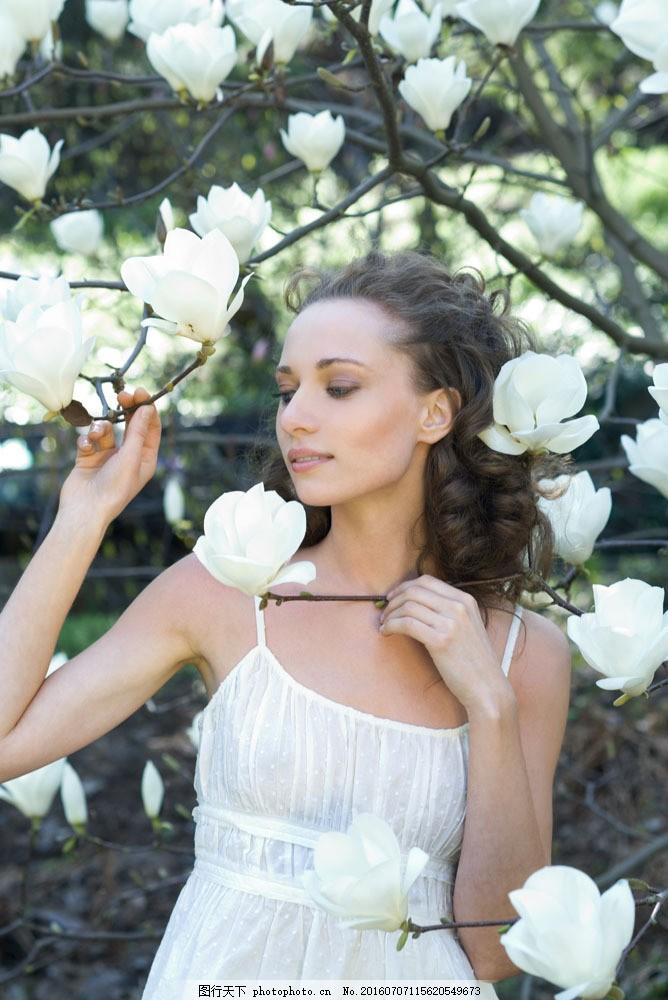 美女与鲜花摄影图片
